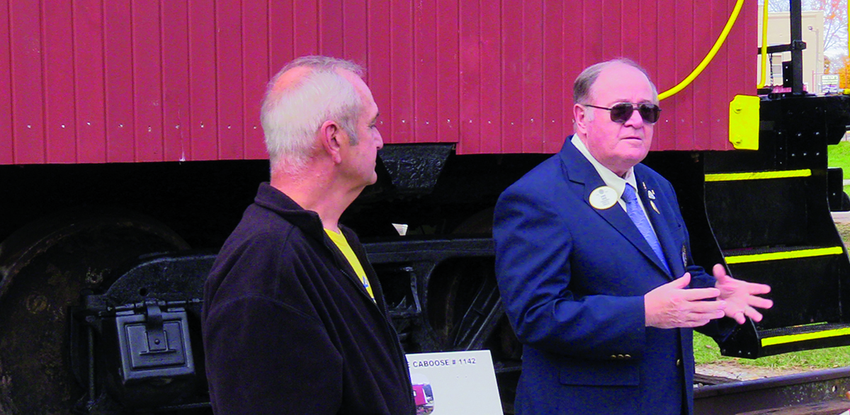d5a7b5e7f88 Lions Club District Governor James Reeves (right) speaks during the ribbon  cutting ceremony while Rick Morris